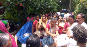 Distributing relief materials -Aymanam
